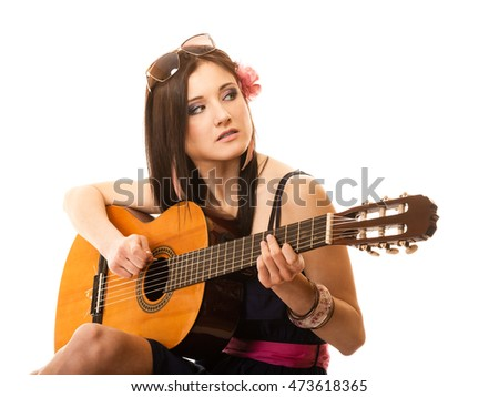 Travel vacation concept. Music lover summer girl playing guitar isolated on white background