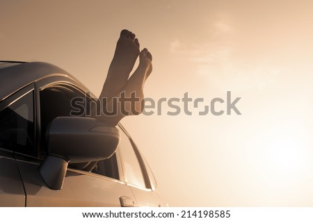 Travel vacation freedom beach vintage concept. Female legs out of car window. - stock photo