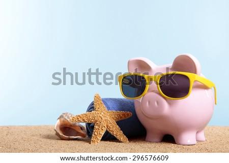 Travel vacation money saving concept, piggybank beach holiday.  Copy space. - stock photo