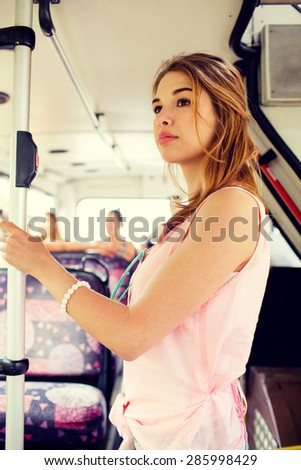 travel, vacation, summer, transport and people concept - teenage girl going by bus