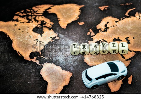 TRAVEL with toy car on grunge world map