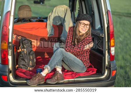 Travel - young woman travel by car - stock photo