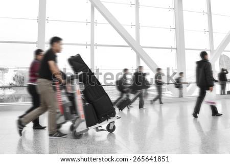 Traveler at airport,motion blur,China  - stock photo
