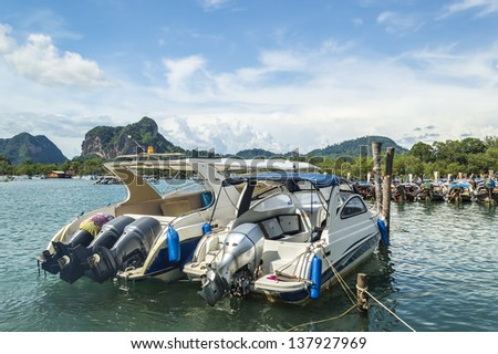 Traveler boats at krabi port with blue skies - stock photo