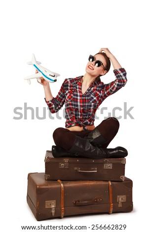 traveler girl on suitcases - stock photo
