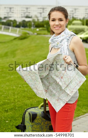 traveler girl searching for her destination on the map