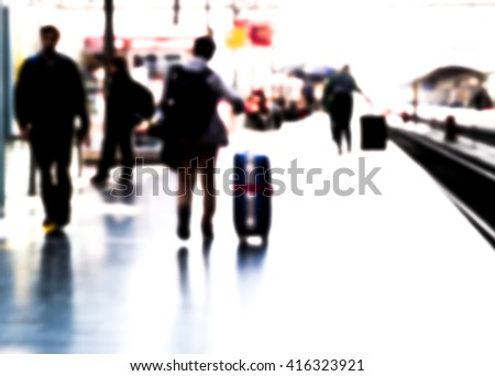 traveler in railway station, blurred, unrecognizable, backgrounds - stock photo