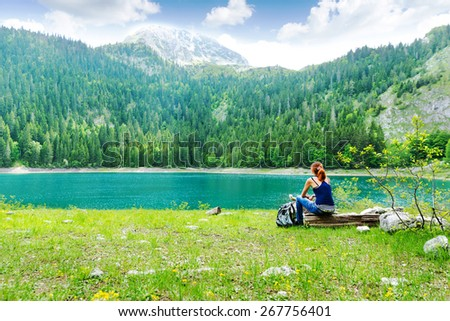 Traveler is resting at the lake - stock photo