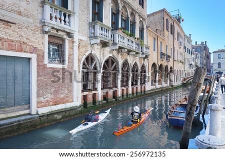 traveler kayaking in canal in Venice, Italy - stock photo