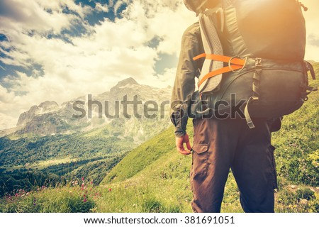 Traveler Man with backpack mountaineering Travel Lifestyle concept mountains on background Summer trip vacations outdoor - stock photo