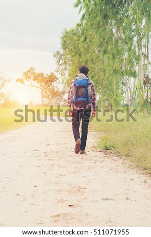 Traveler Man with backpack,Travel Lifestyle concept mountains on background adventure trip vacations.