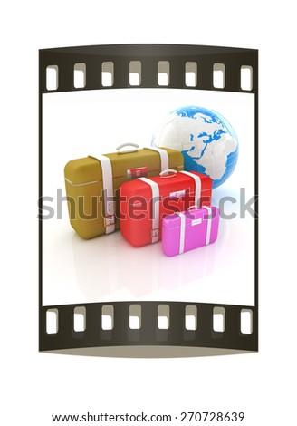 Traveler's suitcases. Family travel concept. The film strip - stock photo
