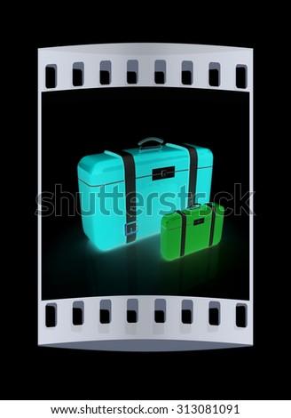 Traveler's suitcases. The film strip - stock photo