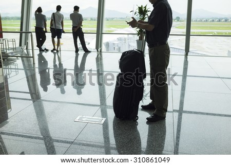 Traveler silhouettes at airport. Concept of business men - stock photo