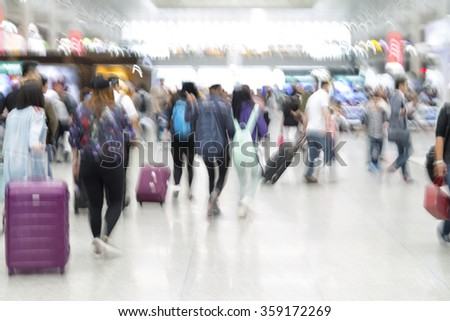 Traveler silhouettes in motion blur, airport interior