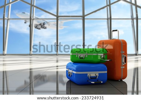 Traveler Suitcases in Airport Terminal Waiting Area. Empty Hall Interior with Large Windows and Flying Airplane behind. Focus on Suitcases. Vacation Concept. - stock photo