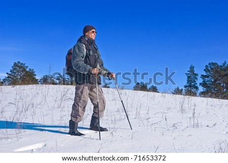 traveler walking in a winter steppe