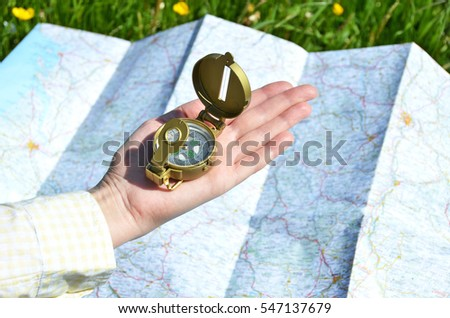 Traveler with a compass in the hand