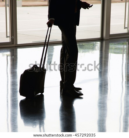 Traveler with a suitcase - stock photo
