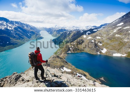 Traveler with backpack and mountain panorama. Norway - stock photo