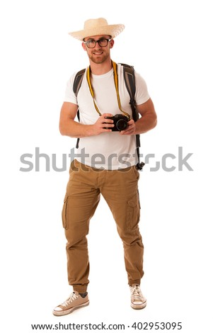 Traveler with straw hat, white shirt, backpack and photo camera exploring new world isolated. - stock photo