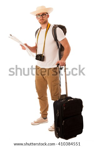 Traveler with straw hat, white shirt, backpack and suitcase waiting for transport isolated. - stock photo