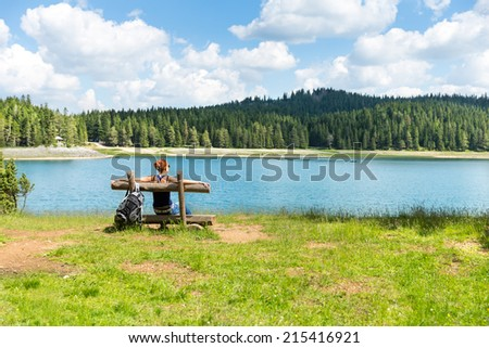 Traveler woman rests on the bench - stock photo