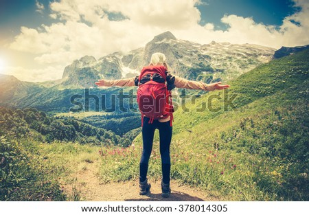 Traveler Woman with backpack hands raised mountaineering Travel Lifestyle concept Summer journey vacations outdoor mountains on background - stock photo