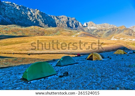 Travelers camp in the wonderful mountains in the morning. Picture was taken during the hike in scenic Caucasus mountains at autumn, Arhiz region, Abishira-Ahuba range, Karachay-Cherkessia, Russia - stock photo