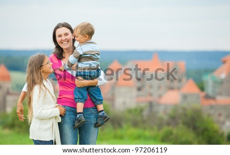 Travelers. Happy famyli of three on a tour of European medieval castles. - stock photo