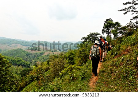 Travelers hiking in jungle mountains in northern Thailand