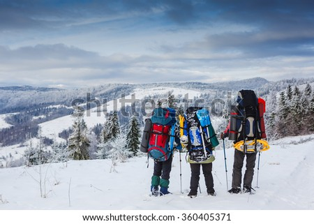 Travelers in winter mountains. Sport lifestyle travel concept  - stock photo