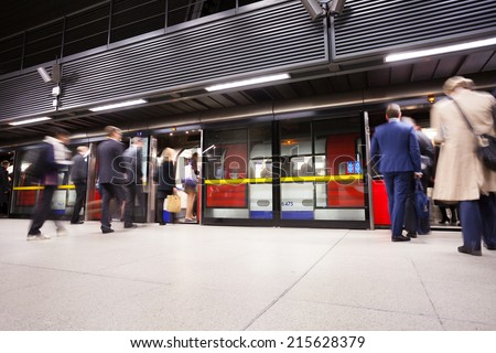 Travelers movement in tube train station, London - stock photo