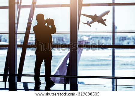 Travelers silhouettes at airport,Beijing - stock photo