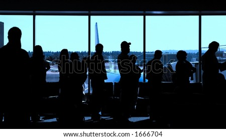 Travelers standing in line to board an airplane