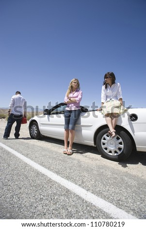 Travelers waiting for someone to help them - stock photo