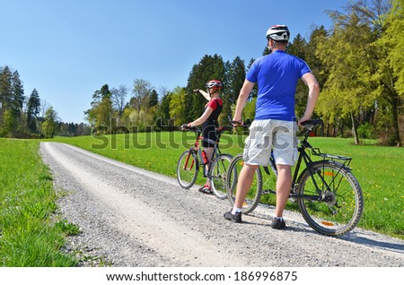 Travelers with mountain bikes - stock photo