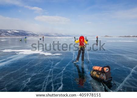 Traveling across Lake Baikal using ice skates - stock photo