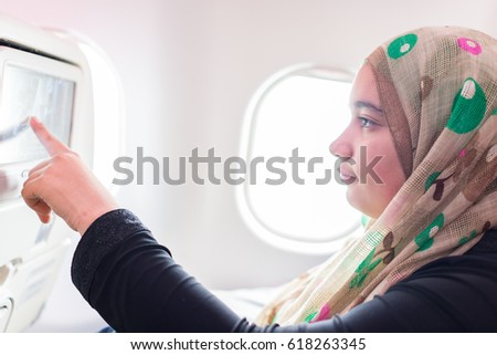 Traveling airplane and using touchscreen technology