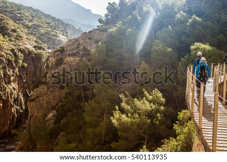Traveling and trekking in nature couple concept. Couple walking by Caminito del Rey path, Malaga, Spain