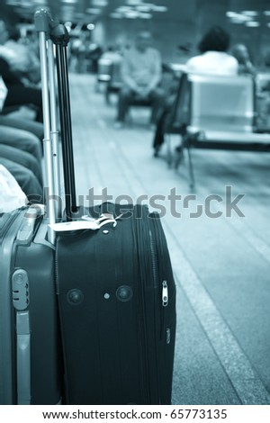 Traveling bag in the airport - stock photo