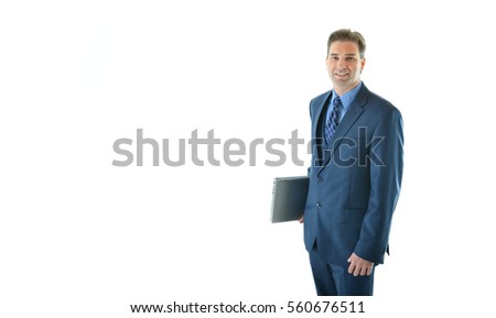 Traveling business or sales man standing holding laptop (half view)