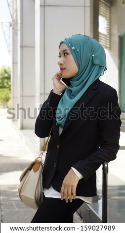 Traveling business woman walking with travel bag - stock photo