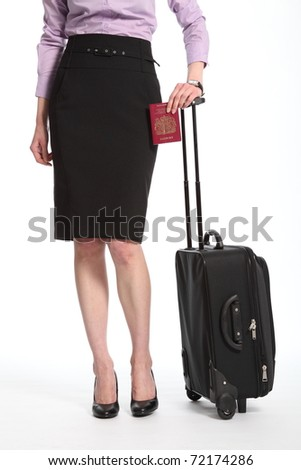 Traveling business woman with suitcase and passport - stock photo