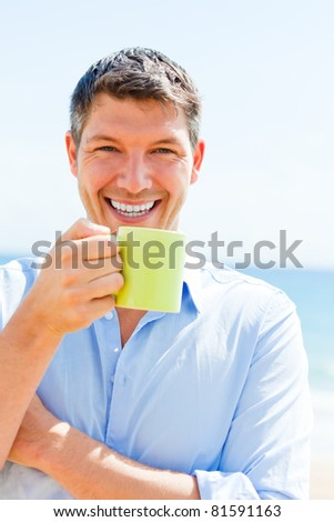 traveling businessman enjoying hotel tea and coffee on the beach - stock photo