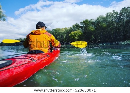 Traveling by kayak on the river on a sunny day.