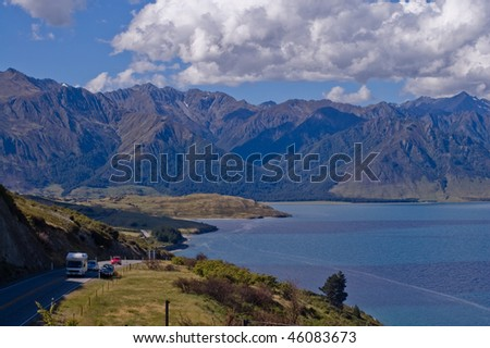 Traveling by motorhome and car, Southern Alps, New Zealand. - stock photo
