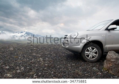 traveling by off road car, dramatic sky in the background - stock photo