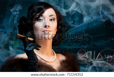 Traveling by train at last century - smoking woman waiting for a train and smokning - stock photo