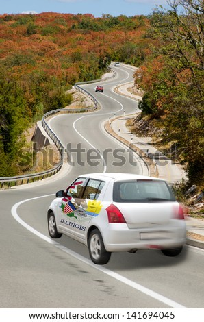 traveling car in flag of us state of illinois colors and beautiful road landscape for tourism and touristic adertising - stock photo